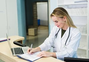 Dental practice manager checking documents